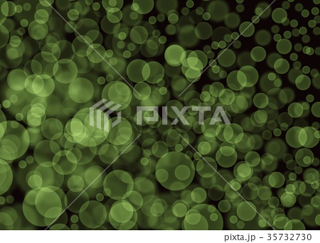 Abstract Green Bokeh Bubbles on Black Background 35732730