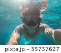 A man with an underwater mask swims in the Sea 35737627