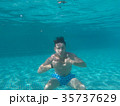 A Man floating under water in the pool 35737629