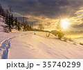rural footpath through snowy hillside at sunset 35740299