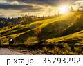 grassy rural hillside near the village at sunset 35793292
