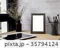 Empty frame photo on wood desk mock up. 35794124