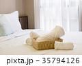 White towel basket on bed decoration in bedroom. 35794126
