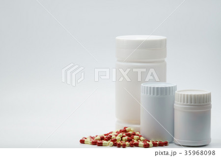 Capsules with closed bottles on white backgroundの写真素材 [35968098] - PIXTA