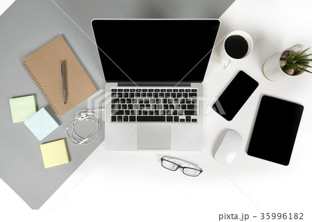 Office table with computer, tablet, mobile phoneの写真素材 [35996182] - PIXTA
