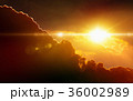 Glowing sunset, dark red clouds, bright sun rays 36002989