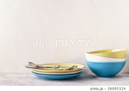 Crockery and cutlery on a light table.の写真素材 [36095324] - PIXTA