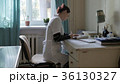 medical doctor in the office at the table. doctor 36130327