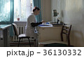 doctor in the office at the table. doctor in a 36130332