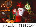 Santa Claus and little elf with magic gift for Christmas 36161144