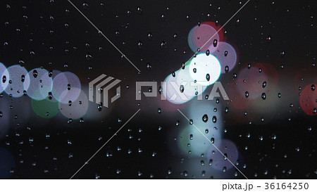 closeup of raindrops on window in night with 36164250