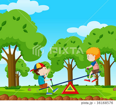 Two boys playing seesaw in the park 36168576