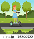 Young redhead woman riding on segway scooter in 36200522