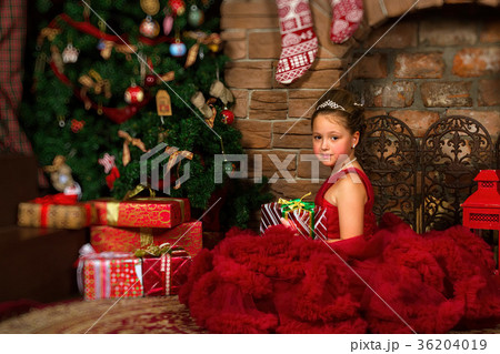 Little winter Princess, girl with Christmas gift 36204019