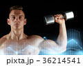 man with dumbbell exercising over black background 36214541