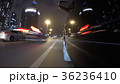 Fast city drive night road POV through city at 36236410