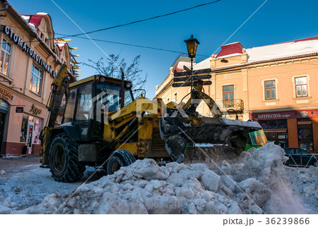 snow removal on streets of old town 36239866