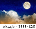 Full moon rising above glowing clouds in night sky 36334825