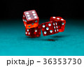 Photo of four playing red dices on green table 36353730