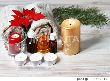 Christmas spa concept with candles and poinsettia.の写真素材 [36467215] - PIXTA