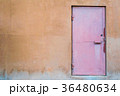 The texture of the old metal door on the plastered 36480634