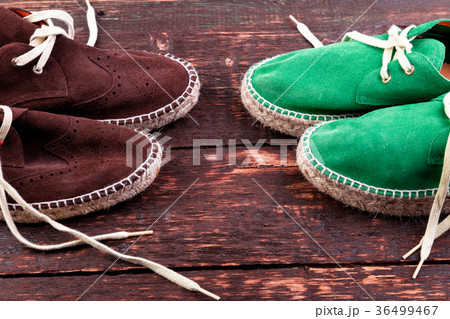 Green and brown suede espadrille shoes on woodenの写真素材 [36499467] - PIXTA