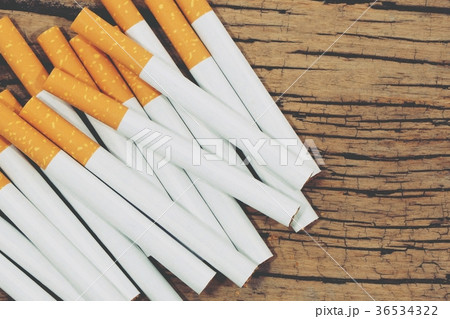 Stack Tobacco Cigarettes with wooden background  の写真素材 [36534322] - PIXTA