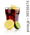 Glass of cold cola soda drink with lime and lemon 36536474