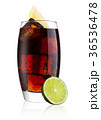 Glass of cold cola soda drink with lime and lemon 36536478
