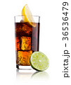 Glass of cold cola soda drink with lime and lemon 36536479