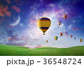 Hot air balloons fly in sunset sky  36548724
