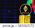 Stack of ether coins with a price chart 36592573