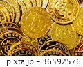 Pile of gold bitcoins 36592576