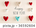 Happy New Year message with blue heart cushions 36592604