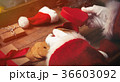 Santa Claus wrapping up Christmas gifts  36603092
