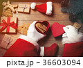 Santa Claus wrapping up Christmas gifts  36603094