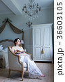 Young pregnant woman in white dress sitting 36603105