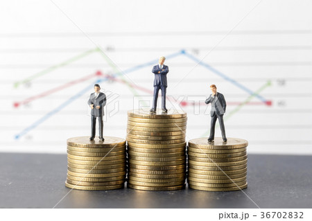Miniature model group of businessman  standing on coin, businessの写真素材 [36702832] - PIXTA