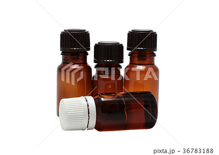 four bottles of aromatherapy oils isolatedの写真素材 [36783188] - PIXTA