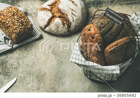 Various bread loaves on grey concrete backgroundの写真素材 [36805692] - PIXTA