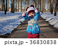 Little girl in winter sunny day 36830838