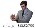 Businessman pretending to hold an invisible object 36852755