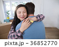 Couple embracing each other while holding keys of new home 36852770