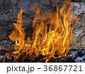 Fire against the backdrop of a stone wall 36867721
