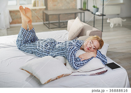 Tranquil woman sleeping on pillow at home 36888616