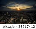 Dark Sky Sun behind Clouds above City at Sunset 36917412