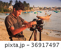 European Photographer Fixes Camera on Sea Beach 36917497