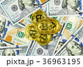 Gold Bit Coin BTC coins rotating on bills of 100 36963195