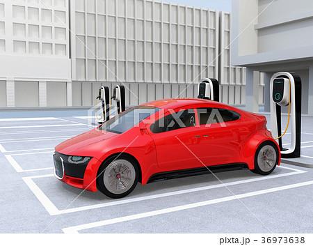 充電スタンドに充電している赤色のスポーツカー 36973638