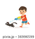 Cute bully boy pouring a black cat out of a water 36996599